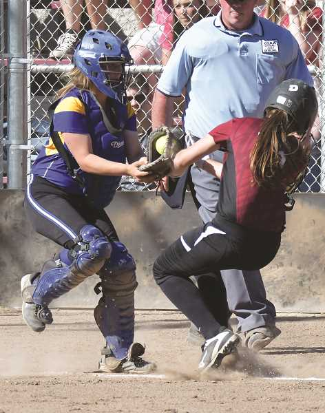 LON AUSTIN/CENTRAL OREGONIAN - Caitlyn Elliott tags Micha Fortune out at home in the bottom half of the second inning of the Cowgirls' 6-3 win over the McLoughlin Pineers. The play, which was set up by a perfect throw from shortstop Aspen Christiansen saved a run and helped Crook County advance to the state semifinals where they will face Gladstone on Tuesday in Prineville.