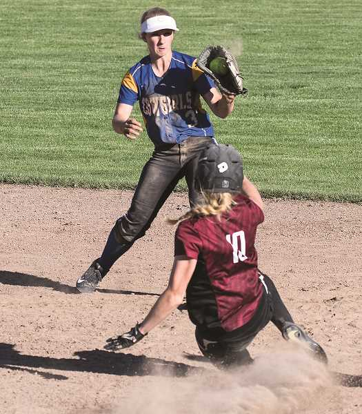 LON AUSTIN/CENTRAL OREGONIAN - Aspen Christiansen catches a throw at second in time ot force out McLoughlin's Sydney Richwine.