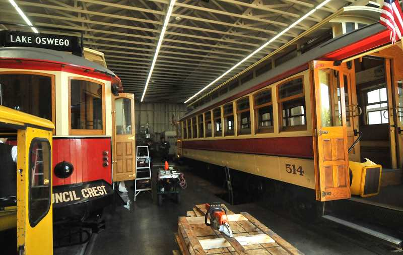 REVIEW PHOTO: VERN UYETAKE - Trolleys 513 (left) and 514 sit in the Lake Oswego trolley barn. Trolley 513 is still undergoing renovation, while 514 is used for regular trips.