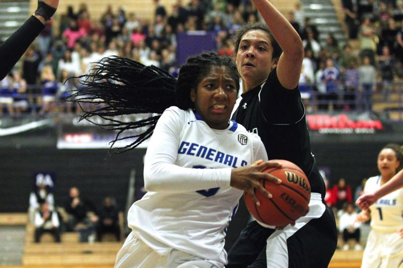 TRIBUNE PHOTO: JAIME VALDEZ - Khiarica Rasheed of Grant High drives to the basket in a state tournament game against South Medford. Also a standout in volleyball and track and field, she was voted 2016-17 Sportswoman of the Year for the PIL.