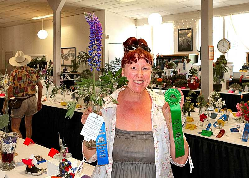 DAVID F. ASHTON - In the fairs Exhibit Hall, Jennifer Vasstabacchi, of the Creston-Kenilworth neighborhood, showed her prize-winning flower in the perennial category - a purple Lupine.
