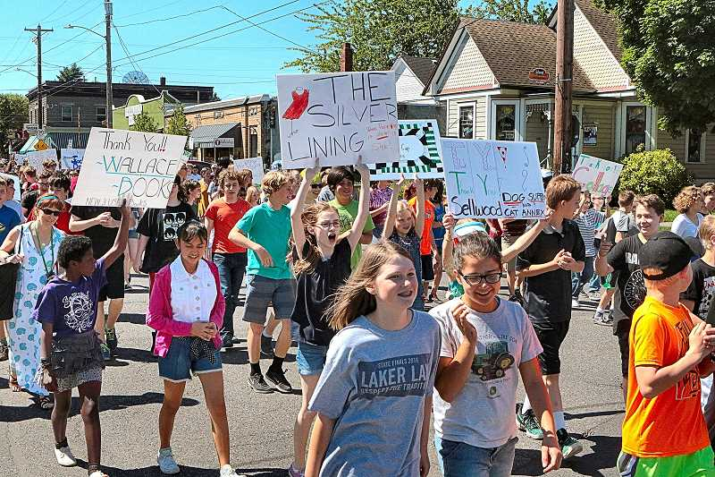 DAVID F. ASHTON - Waving their handmade signs, SMS students thanked the community while walking north through Sellwood on S.E. 13th.