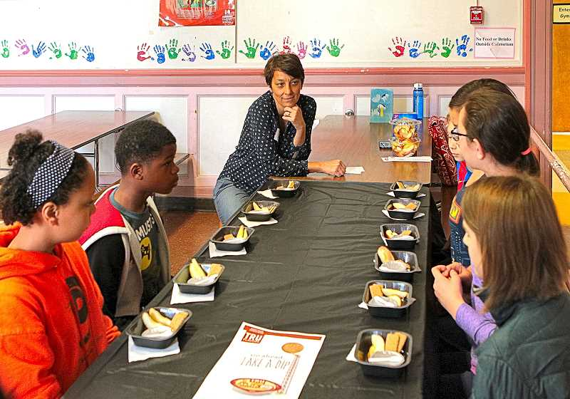 DAVID F. ASHTON - Llewellyn Elementary School students prepare to sample new Cinnamon Apple Dippers in a special taste test for a Salem food company.