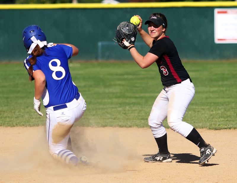 DAN BROOD - Tualatin senior second baseman Amanda Reser (right) looks to make a throw to first after forcing Grants Pass sophomore Marissa Eilenberger out at second.