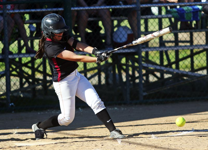 DAN BROOD - Tualatin sophomore Andrea Gomez puts the ball in play during the 4-0 win over Grants Pass.
