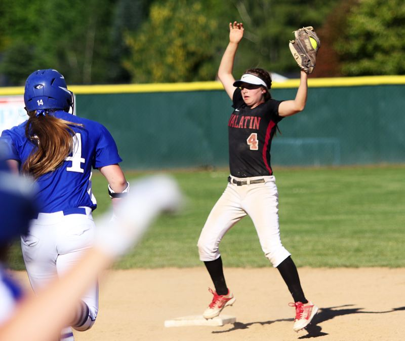 DAN BROOD - Tualatin shortstop Bella Valdes (4) looks to step on second base after making a leaping catch of a thrown ball during Friday's game.