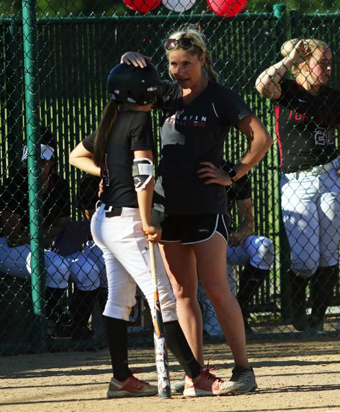 DAN BROOD - Tualatin head coach Jenna Wilson talks to freshman Bella Valdes right before Valdes' two-run single in the fifth inning of Friday's playoff game.