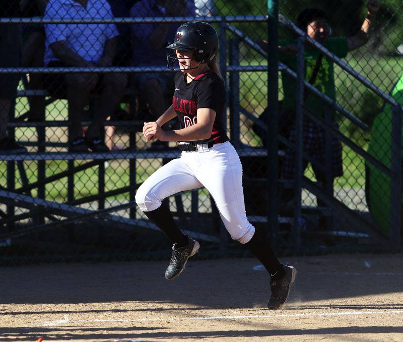 DAN BROOD - Tualatin junior Kaya Laird sprints home to score a run in the fifth inning of the Wolves' 4-0 win over Grants Pass.