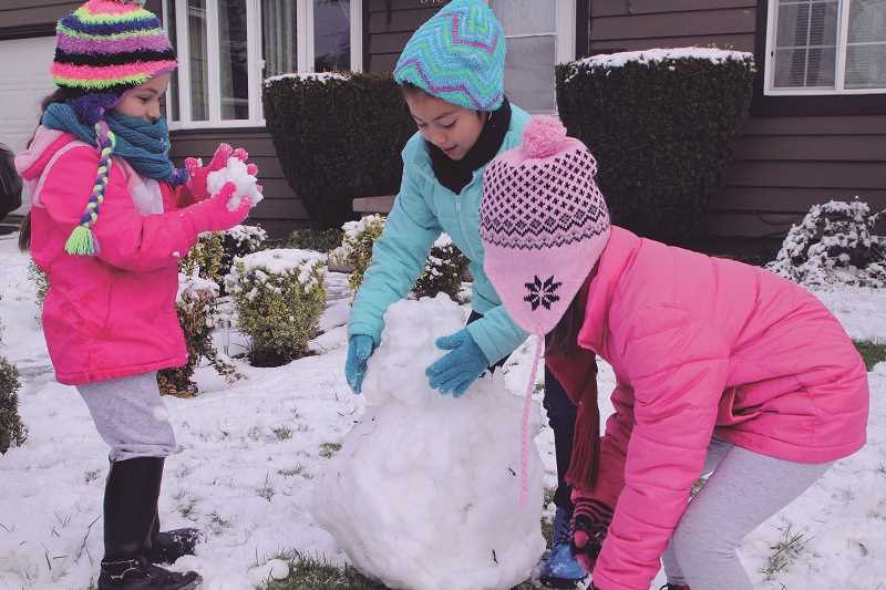 INDEPENDENT FILE PHOTO - Woodburn residents played in the snow during one of the inclement weather days this school year.