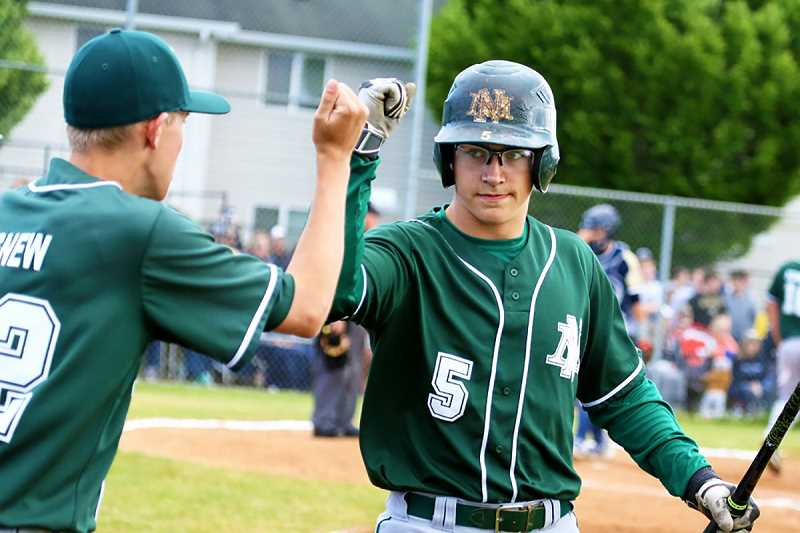 JO WHEAT - North Marion junior Andy Schmitz (right) was 1-for-3 with an RBI and a run scored in the Huskies' first round defeat at No. 7 Banks on May 24. Schmitz was one of 10 North Marion players named to the Oregon West All Conference team at the end of the regular season.