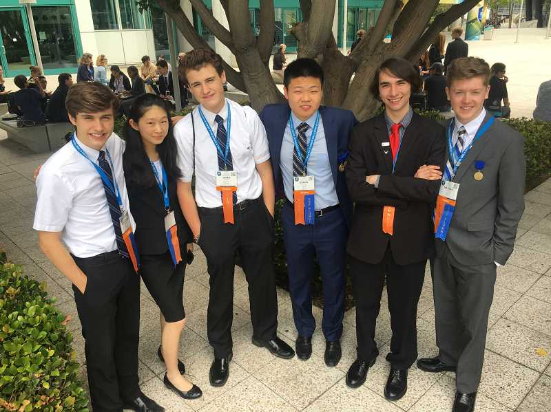 SUBMITTED PHOTO - From left, Kristopher Wieland, Jessica Yu, Jared Wieland, Daniel Tang, Jareth Anderson and Nathan Tidball take a picture at the Intel International Science and Engineering Fair in Los Angeles.