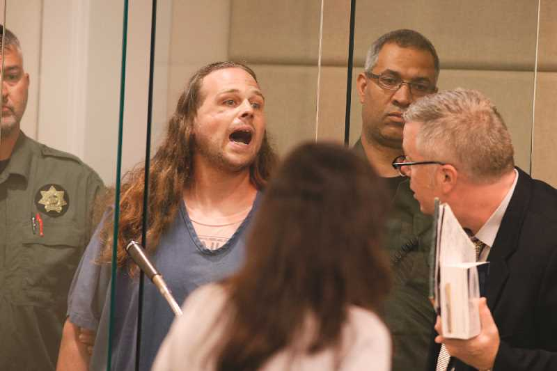 PHOTO: BETH NAKAMURA - Max stabbing suspect Jeremy Christian is arraigned in Multnomah County Circuit Court in Portland on Tuesday, May 30. Christian shouted, 'Free speech or die. Get out if you don't like free speech ... you call it terrorism, I call it patriotism ... die.' Christian is accused of killing two men on a commuter MAX train on Friday after the men tried to prevent Christian from harassing two girls.