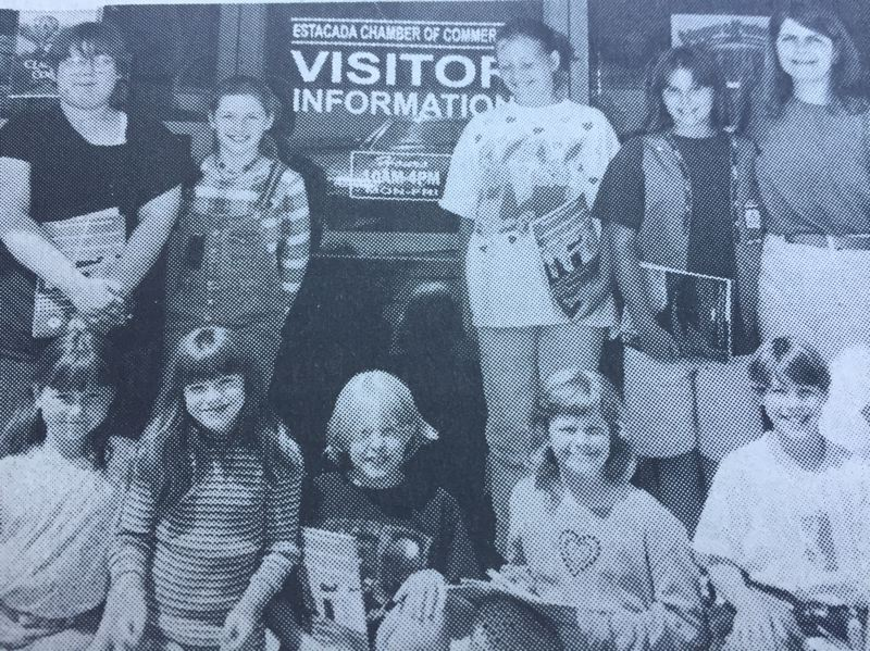 ARCHIVE PHOTO - In 1997, the Camp Fire Kids were preparing to promote Estacada across the world. Pictured here at the Chamber of Commerce Office after they picked up information to send to their new pen pals are club members Kyra Crowston, Heather Harlan, Annie Schuler, Kellsey Degrandpre, Sean Harlan, Maigen Schuler, Holly Brown, Kari Goudge, Kimberly Degrandpre and club leader Shera Degrandpre.