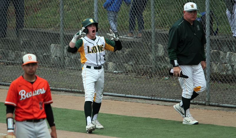 TIDINGS PHOTO: MILES VANCE - West Linn junior James Marshall lets out a yell after his fifth-inning bunt scored teammate Jonathon Kelly to tie the score and set the table for his team's 3-1 win over the Beavers in the Class 6A state semifinals at West Linn High School.
