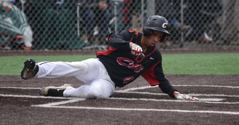 PAMPLIN MEDIA: DAVID BALL - Clackamas sophomore Alex Claxton slides home with the teams final run on Bubba Jahas single through the middle in the sixth inning.