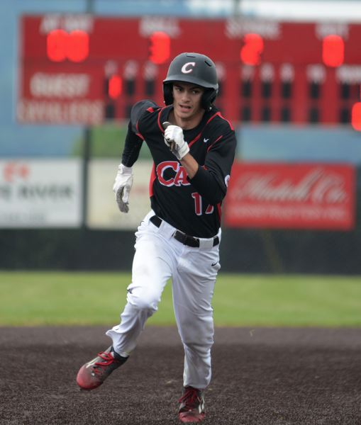 PAMPLIN MEDIA: DAVID BALL - Clackamas senior Casey Peterson moves around the bases on his way to scoring the teams first run in Tuesdays 6-2 win over Sheldon.