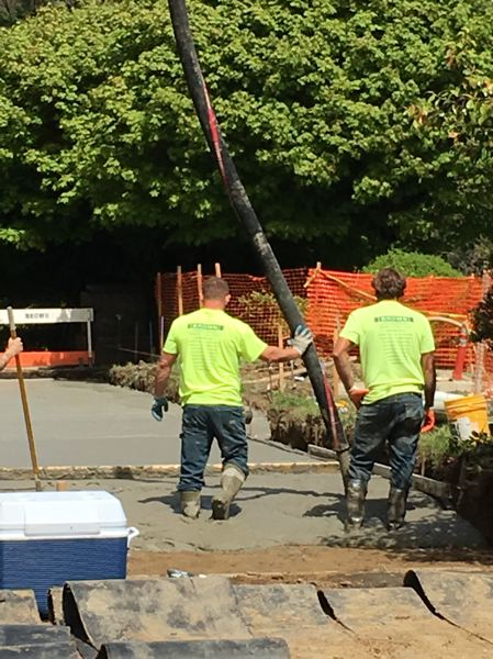 SUBMITTED: PORTLAND PARKS & RECREATION - With the ADA project underway, new ramps are being poured in the construction area. Concrete pouring vehicles use a giant hose and crane to pour into the garden from above.