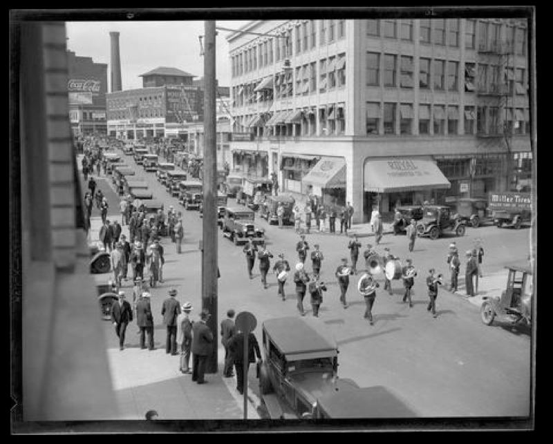 COURTESY OF THE OREGON HISTORICAL SOCIETY - A band marches down a street in 1920s downtown Portland. This photo is part of the Oregon Journalnitrate negative collection.