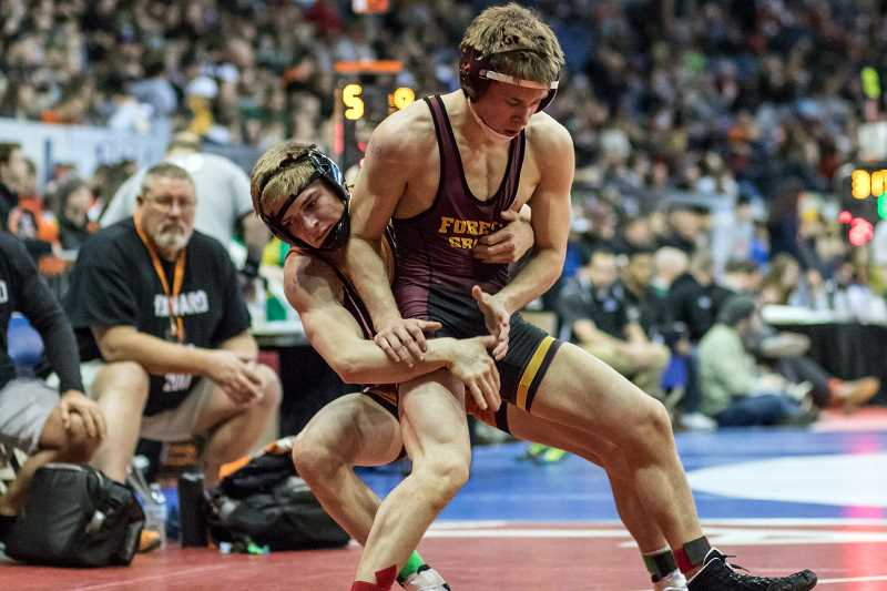 PAMPLIN MEDIA PHOTO - Forest Grove's Lucas Higginbotham competes at the Memorial Coliseum during last season's OSAA State Wrestling Championships, where he placed third.