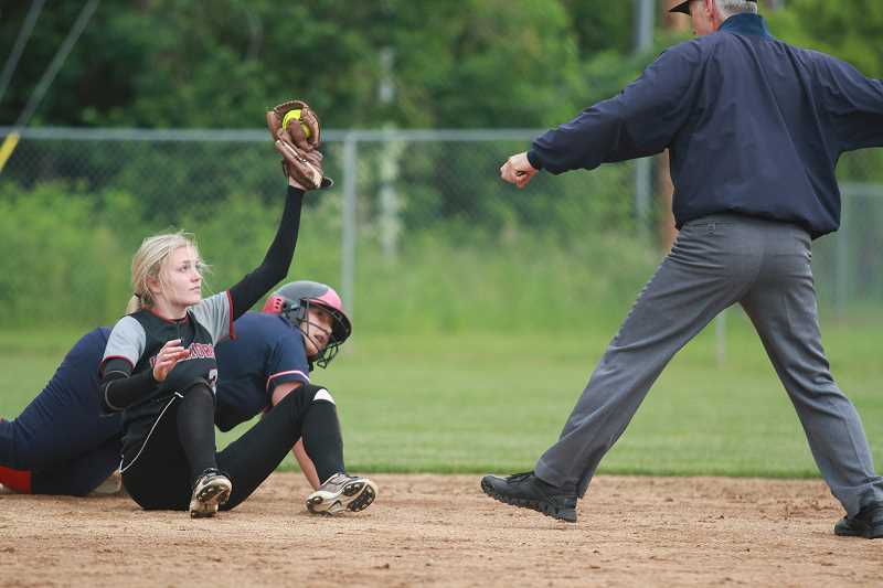 PHIL HAWKINS - Kennedy senior Rheannan Hernandez and North Douglas senior Kalli Frieze look to the umpire for a call at second base after Hernandez attempted to leg out a double, but was called out, in Trojans' 3-2 loss to the Warriors in the 2A/1A semifinals on Tuesday.
