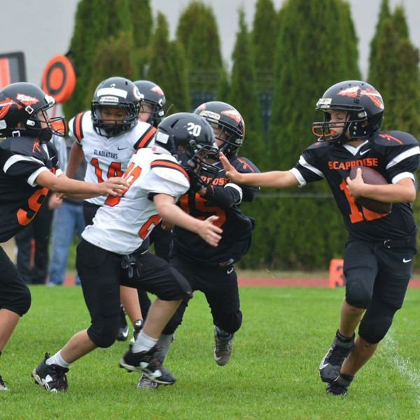 PHOTO COURTESY: SCAPPOOSE YOUTH FOOTBALL - Incoming fifth-grader Brandon Neilson, right, and football enthusiasts can sign up for Scappoose Youth Football between now and July 1, and early enrollment is appreciated.