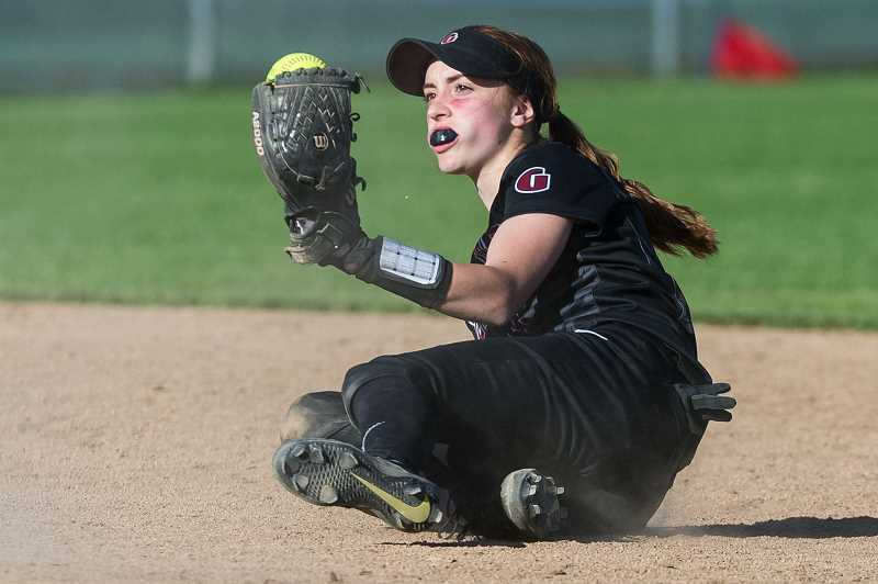 HILLSBORO TRIBUNE PHOTO: CHRISTOPHER OERTELL - Glencoe's Morgan DeBord makes a sliding catch during the Tide's playoff win over Barlow May 24.