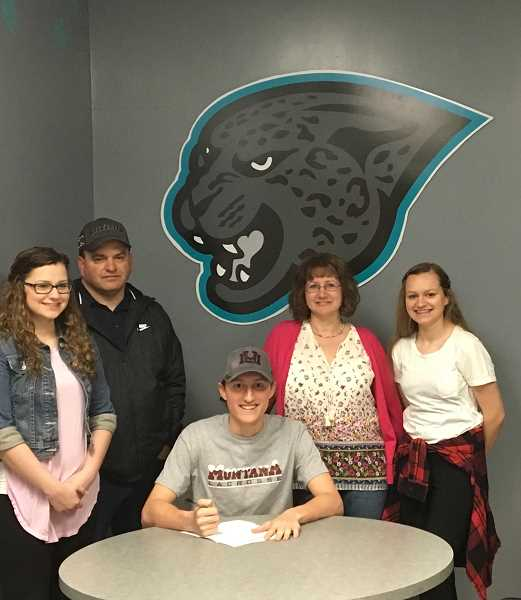 COURTESY PHOTO - Century lacrosse player Gavin Mannen signs his letter of intent to play lacrosse at the University of Montana.