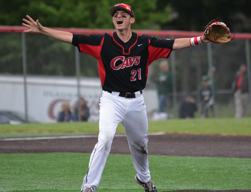 OUTLOOK PHOTO: DAVID BALL - Clackamas High junior Greg Mehlhaff celebrates after converting the final out during the Cavaliers 6-2 semifinal win over Sheldon on Tuesday.