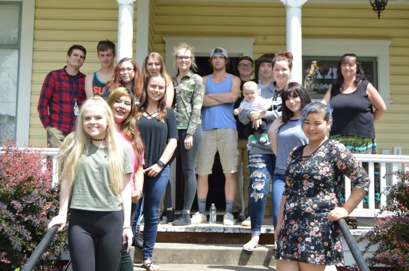 SPOTLIGHT PHOTO: COURTNEY VAUGHN - Students of Scappoose Academy gather at the Watts House Pioneer Museum in Scappoose. The school has helped with tasks at the Watts House all school year.