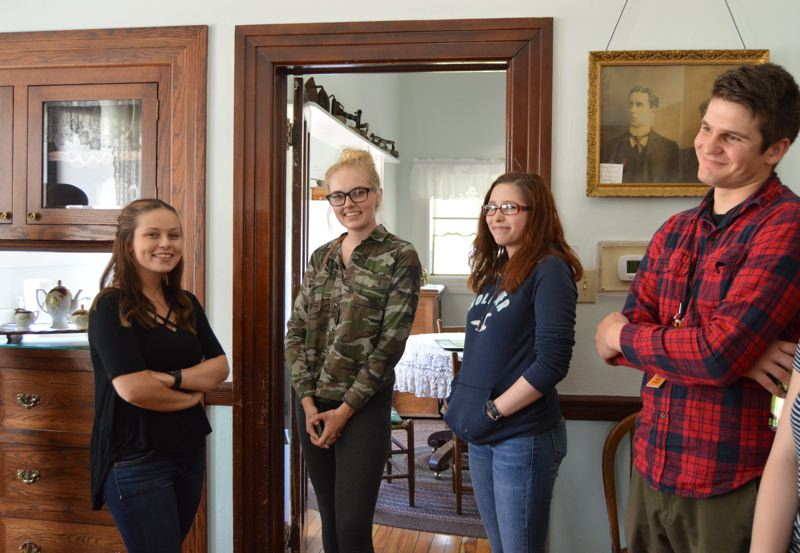 SPOTLIGHT PHOTO: COURTNEY VAUGHN - Scappoose Academy students convene in the dining room at the Watts House during a Wednesday afternoon school day. Pictured left to right: Emily Howard, Courtney Hamilton, Eve Wolfe and instructor Mike Turner.