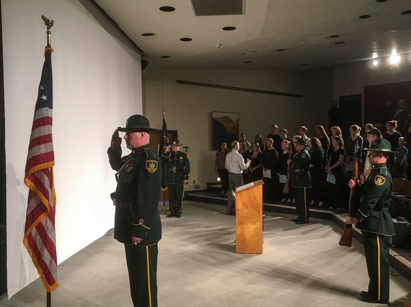 CONTRIBUTED PHOTO - The Multnomah County Sheriff's Honor Guard presents the colors as the Corbett High School choir sings at the ceremony honoring law enforcement officers, including canines, killed in the line of duty in 2016.