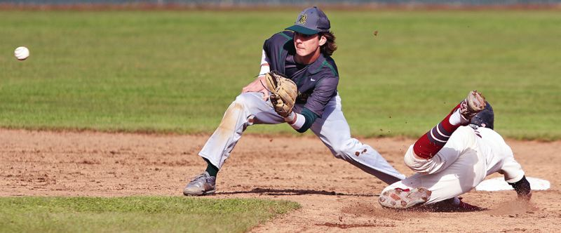 PMG PHOTO: DAN BROOD - West Linn shortstop Jonathon Kelly takes a throw during his team's 3-2 win over Tualatin.