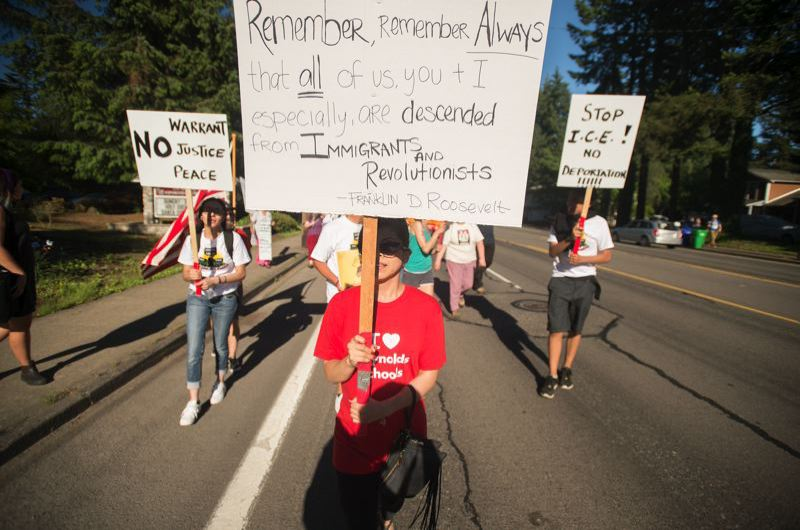 OUTLOOK PHOTO: JOSH KULLA - One hundred people came together Tuesday evening to march across Rockwood in protest of U.S. Immigration and Customs Enforcement (ICE) raids in East Multnomah County.
