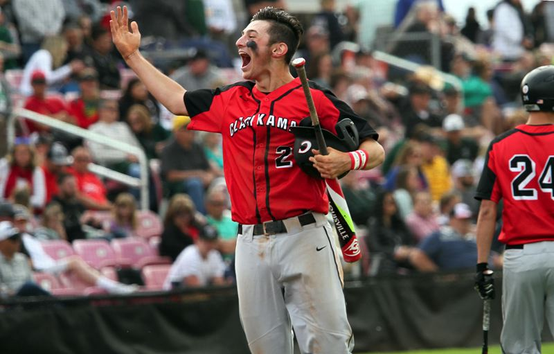 PMG PHOTO: MILES VANCE - Clackamas' Greg Mehlhaff yells to his bench and the Clackamas fans after scoring the first run in his team's 5-1 victory over West Linn in the Class 6A state championship game at Volcanoes Stadium in Keizer.