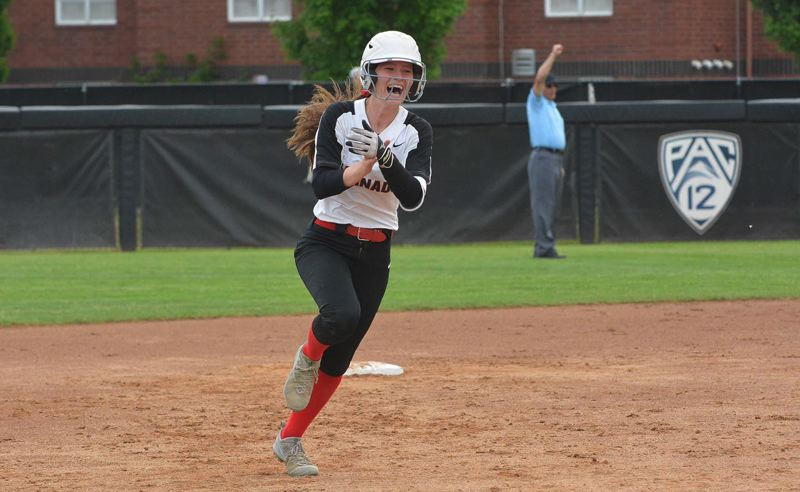 TIMES PHOTO: MATT SINGLEDECKER - North Medford outfielder Jordan Neathamer celebrates her opposite field home run against Westview in the bottom of the second inning of the Class 6A state championship game.