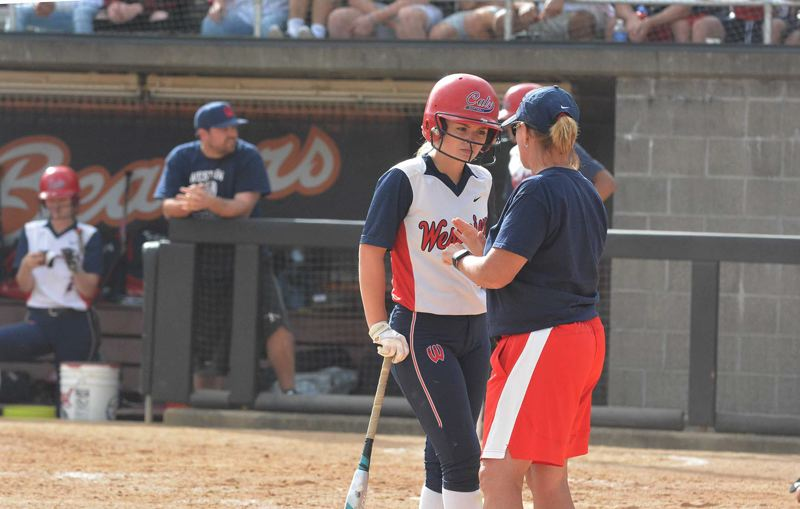 TIMES PHOTO: MATT SINGLEDECKER - Westview senior centerfielder Emma Williams discusses strategy with head coach Ronda McKenzie in the Class 6A state championship game.