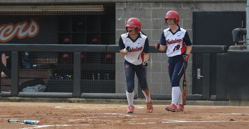 TIMES PHOTO: MATT SINGLEDECKER - Westview junior Reece Martin and Westview senior catcher Natalie Munson celebrate a score during the Class 6A softball championship game on Saturday.