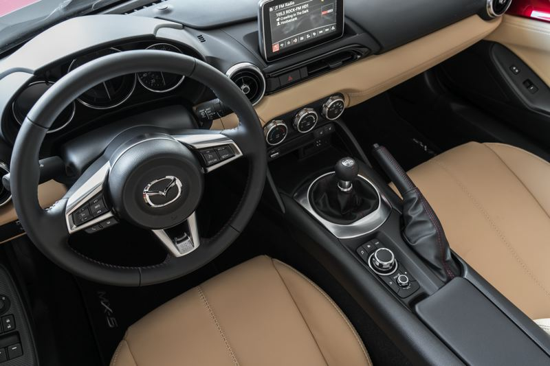 MAZDA USA - The interior of the 2017 Mazda MX5 Miata is clean and functional, with a console knob-controlled touch screen the most contemporary feature.