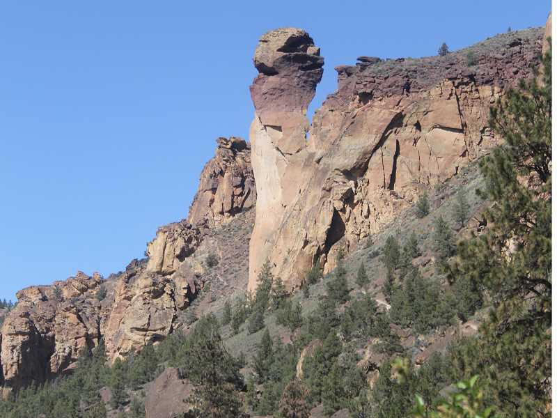 WILL DENNER/MADRAS PIONEER - The monkey face rock formation at Smith Rock State Park, as seen from the Mesa Verde trail near the Crooked River.