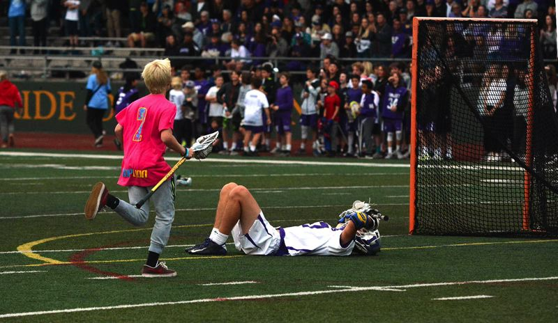 TIMES PHOTO: MATT SINGLEDECKER - Sunset senior defender Kyle Duitsman lays on the West Linn field surface in the finals second of the Apollos state title loss.