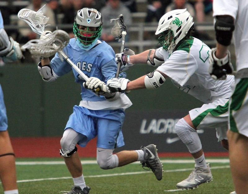 PAMPLIN MEDIA GROUP: MILES VANCE - Senior midfielder Henry Morrissette (left) of Oregon Episcopal School looks to get around a defender during last week's state semifinals. OES beat host West Linn 11-10 in overtime.