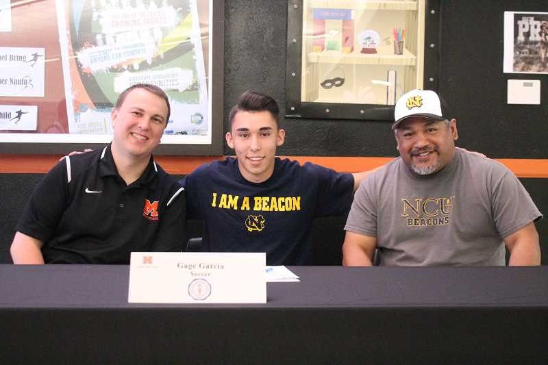 PIONEER PHOTO: CONNER WILLIAMS  - Molalla senior Gage Garcia (middle) will continue his soccer career at Northwest Christian University inEugene in the fall, where he'll study either Sports Medicine or Criminology. In this photo, he's joined by highschool coach Ryan Gates (left) and NCU coach Benny Flores (right).
