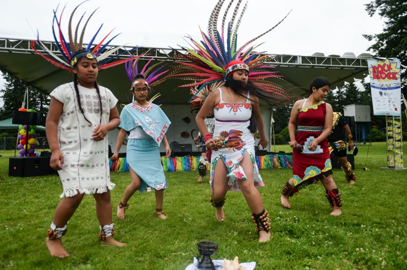 OUTLOOK PHOTO: JOSH KULLA - Members of Danza Azteca perform Saturday at Rock the Block at the Rockwood Commons.