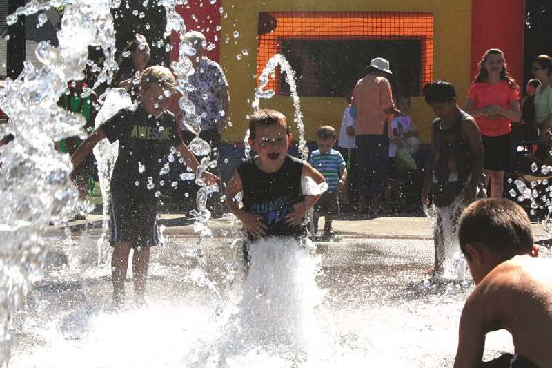 INDEPENDENT FILE PHOTO - The Rivenes Park Splash Pad in Hubbard (pictured) will no longer be the closest splash pad for families in Woodburn. City staff said the Centennial Park Splash Pad and Rain Garden is expected to be open by the end of next week.