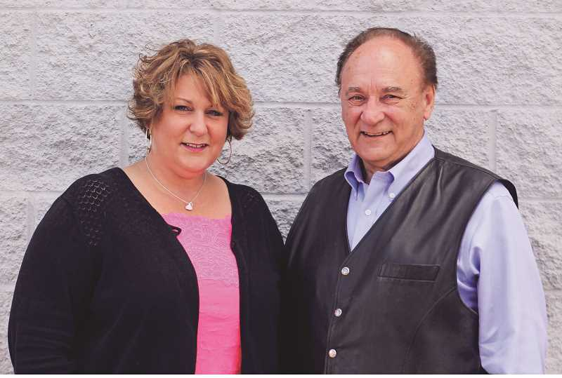 INDEPENDENT PHOTO: JULIA COMNES - Ed Krupicka and his daughter Heidi Hammack have been in the insurance business for a combined 80 years. Krupicka, who marked his 50th anniversary with State Farm last week, said his favorite part of being an insurance agent is connecting with his clients.