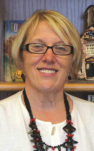INDEPENDENT FILE PHOTO - Irene Novichihin, principal at Heritage Elementary School, is retiring after 32 years with Woodburn School District.