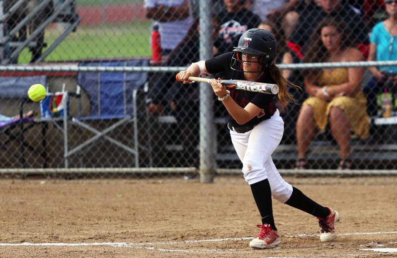 DAN BROOD - Tualatin freshman Bella Valdes looks to put down a bunt during the Wolves' state semifinal playoff game at North Medford.
