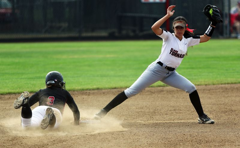 DAN BROOD - Tualatin senior Amanda Reser (left) dives back to second base as North Medford second baseman Alex Barry makes a catch during the first inning of the state playoff semifinal game.