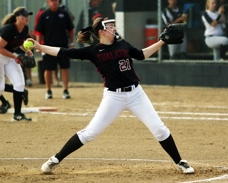 DAN BROOD - Tualatin junior Megan Woodward gets ready to fire in a pitch during the Wolves' semifinal game at North Medford.