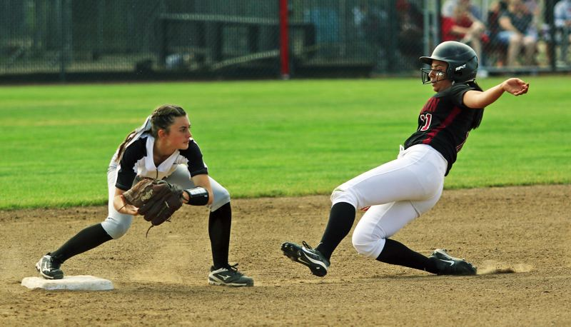DAN BROOD - Tualatin junior Zoe Olivera (right) slides to second base as North Medford shortstop Lauren Barry makes catch at the bag during the state playoff semifinal game.
